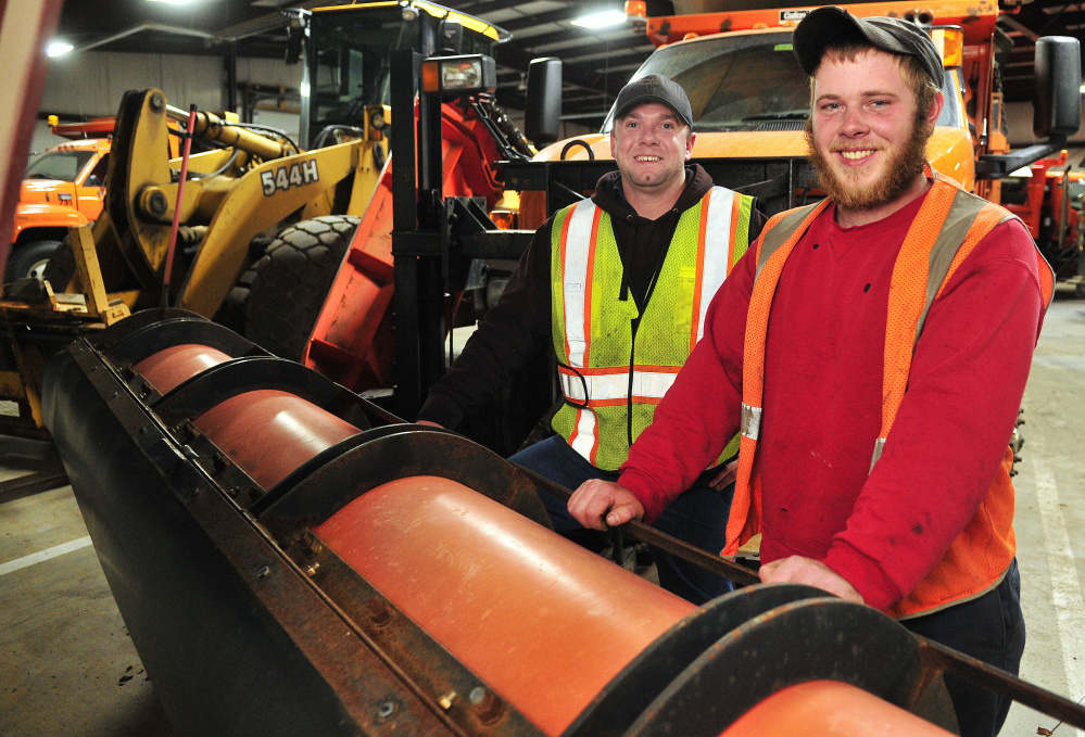 City workers Manny Proctor, left, and Justin Miller, both of whom recently got certified to drive a plow truck for the city this winter, pose for a portrait on Thursday at the John Charest Public Works Facility in Augusta.
