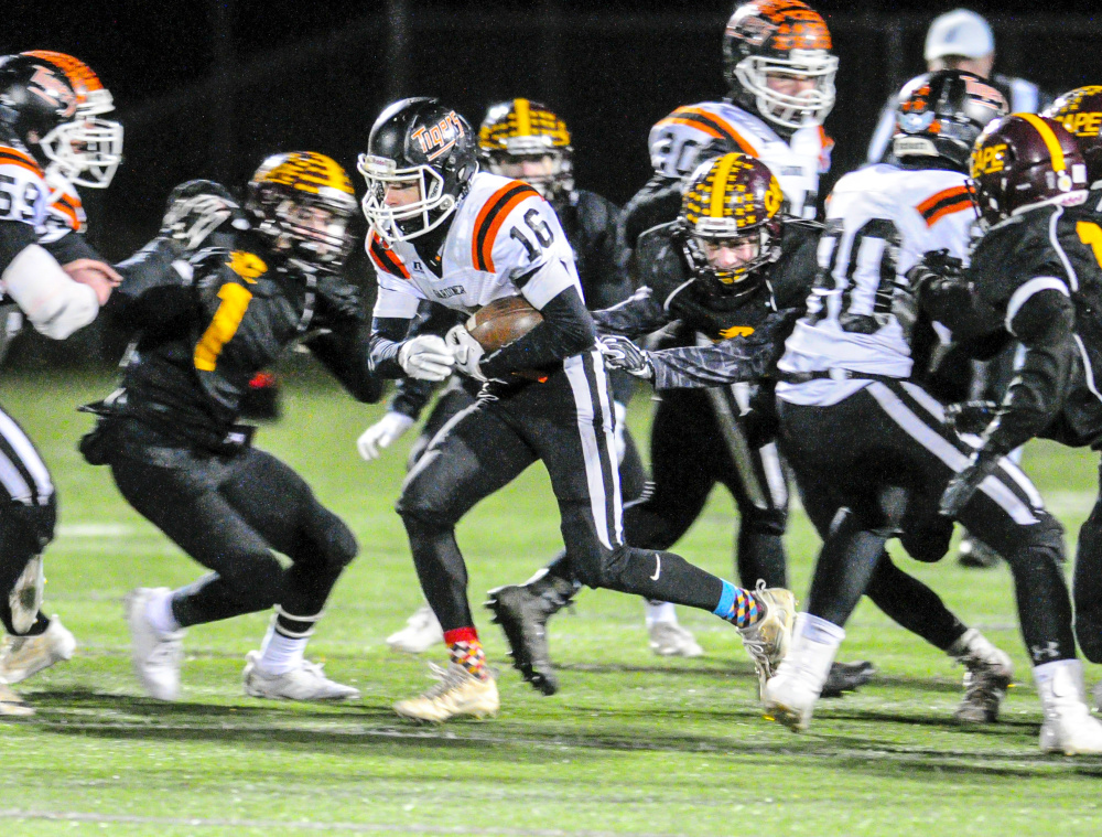 Gardiner running back Collin Foye looks for extra yards during the Class C South title game Friday at Cape Elizabeth.