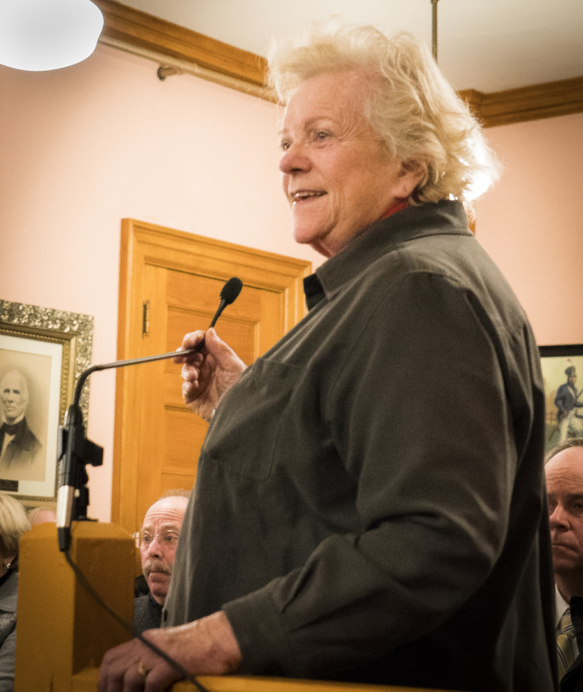 Linda Bean, center, addresses the Hallowell City Council on Monday evening during a discussion about the city's plan to move the historic Dummer House. Bean, the granddaughter of L.L. Bean's founder, owns the Dummer House and adjacent property.