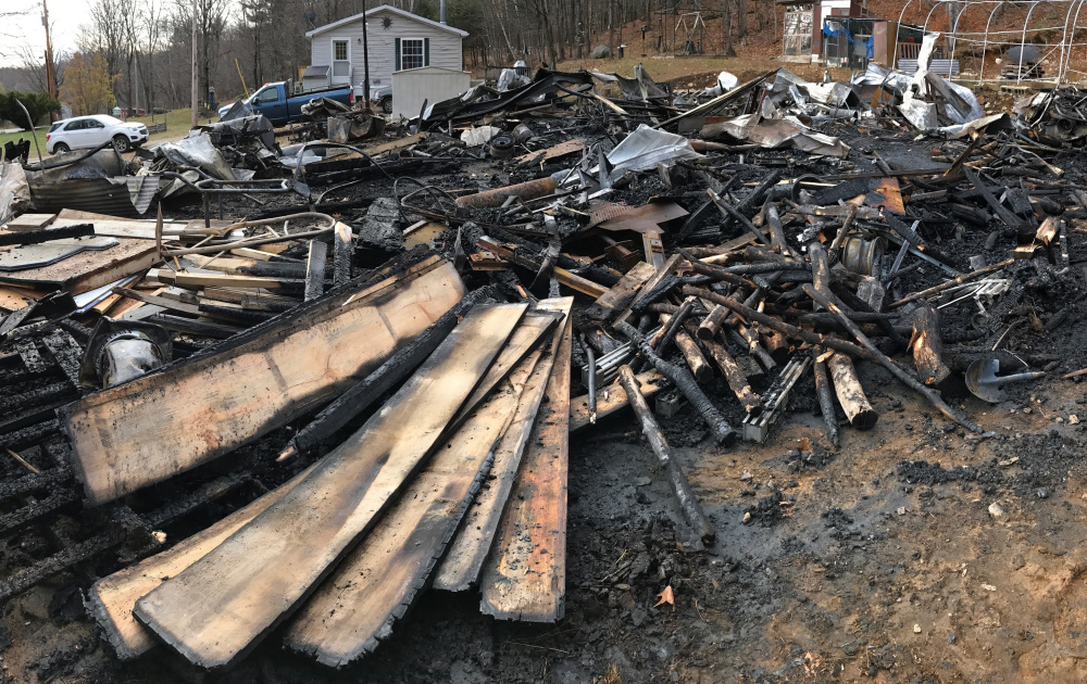 Fire destroyed this garage early Tuesday morning at 222 Hunts Meadow Road in Whitefield.