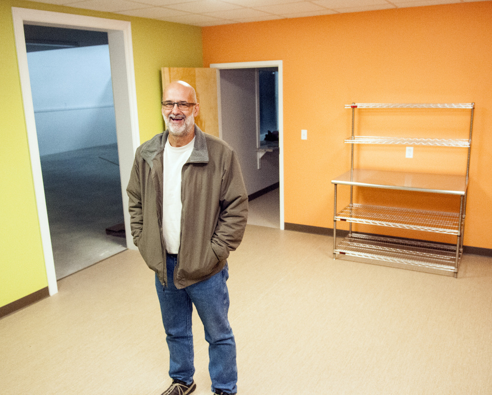 Executive Director Alan Smith leads a tour Tuesday at the new site of the Augusta Food Bank in Augusta.