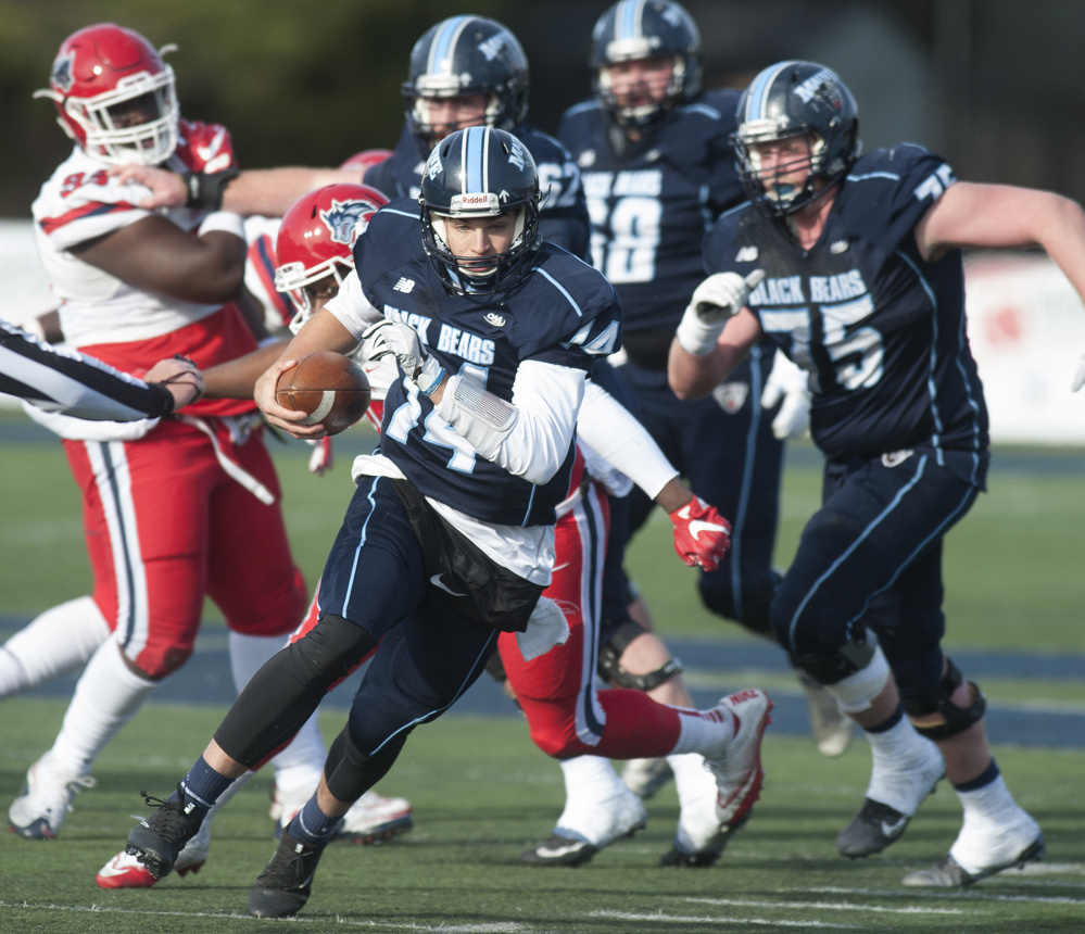 University of Maine ball carrier Chris Fergson rushes for a first down during a game against Stoney Brook on Saturday at Alfond Stadium in Orono.