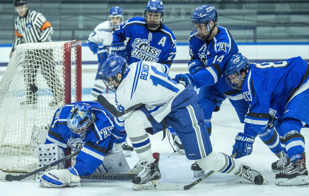 Colby College's Mario Benicky (18) tries to score on University of Massachusetts at Boston goalie Bailey MacBurnie (1) at Colby College in Waterville on Saturday.
