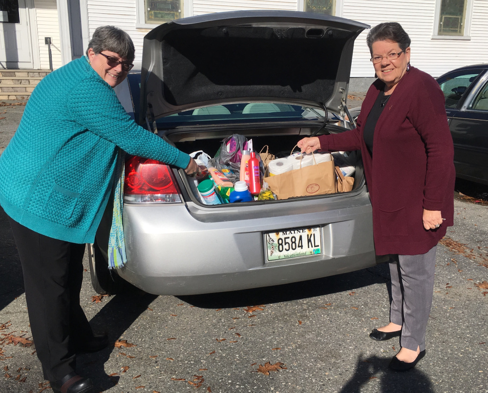 Kappa members Mary Whitten, of Gardiner, left, and Betty-Jane Meader, of Waterville, load the car for delivery of a variety of items to The Essentials Closet.