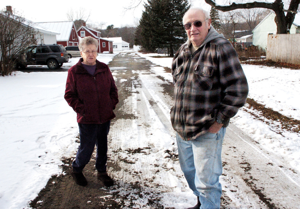 Helene and Charles Bolstridge talked with Skowhegan Selectmen about having their street plowed shortly before they were pictured on it on Dec. 8, 2016. The town was not going to plow the street because it had not been accepted as a street by the town. The Bolstridges and neighbors hired a lawyer who helped solve the problem with the town, which has agreed to plow and sand the street under the terms of a public easement.