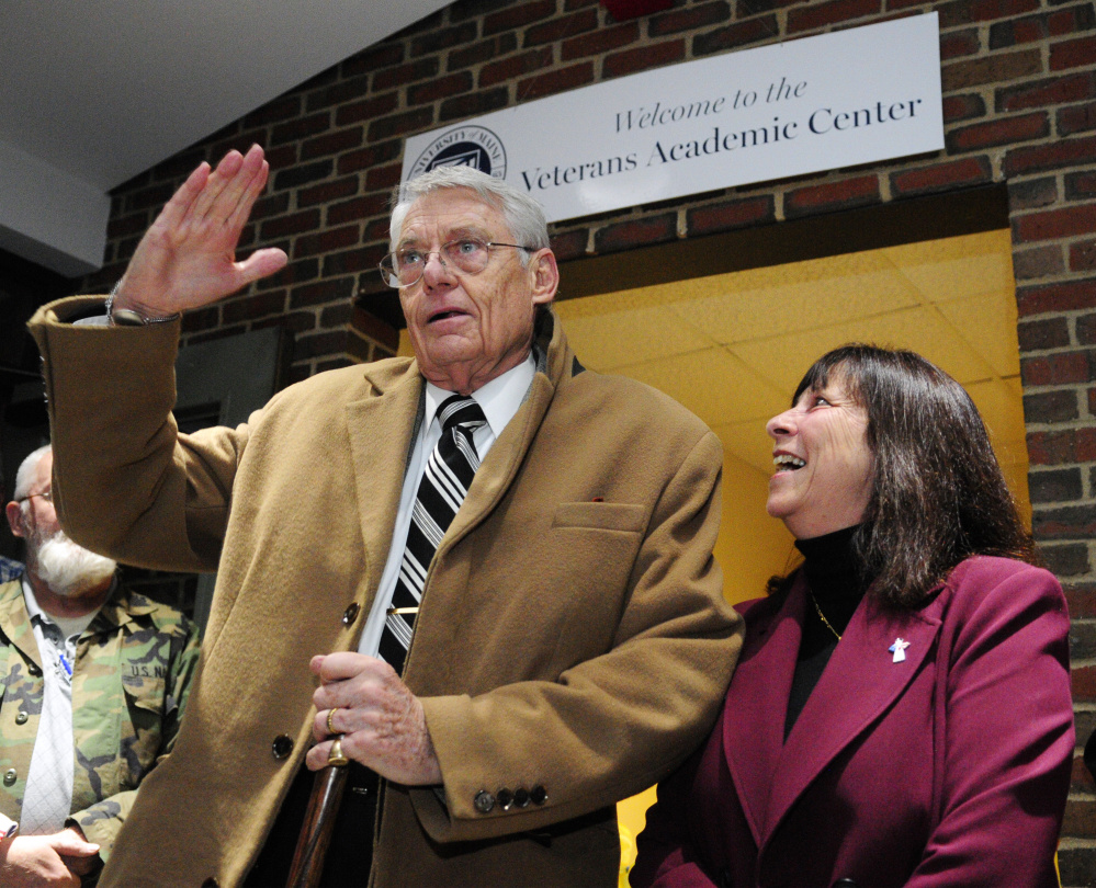Robert Fuller, left, salutes after giving brief remarks Thursday at the opening of the new Veterans Academic Center at the University of Maine at Augusta. Amy Line, the school's coordinator of veterans' affairs, is at right. Fuller, a former Navy captain, and his family foundation, The Windover Foundation, donated most of the money for the project.