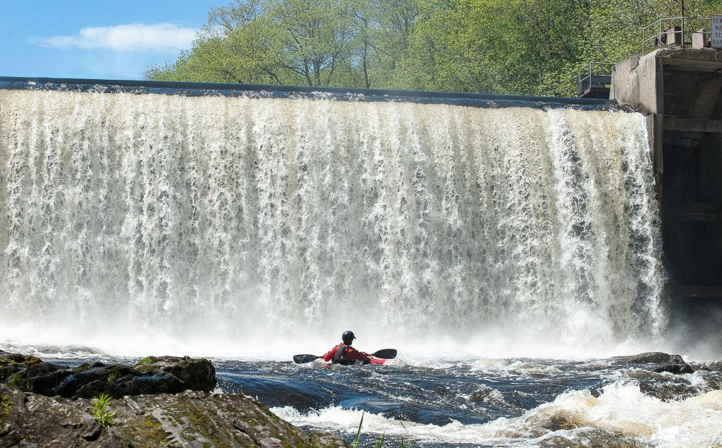 Ryan Galway makes his way onto the Little Androscoggin River in Auburn behind Barker Mill Arms in May. The trip was organized to explore the recreational potential of the river just below the dam.