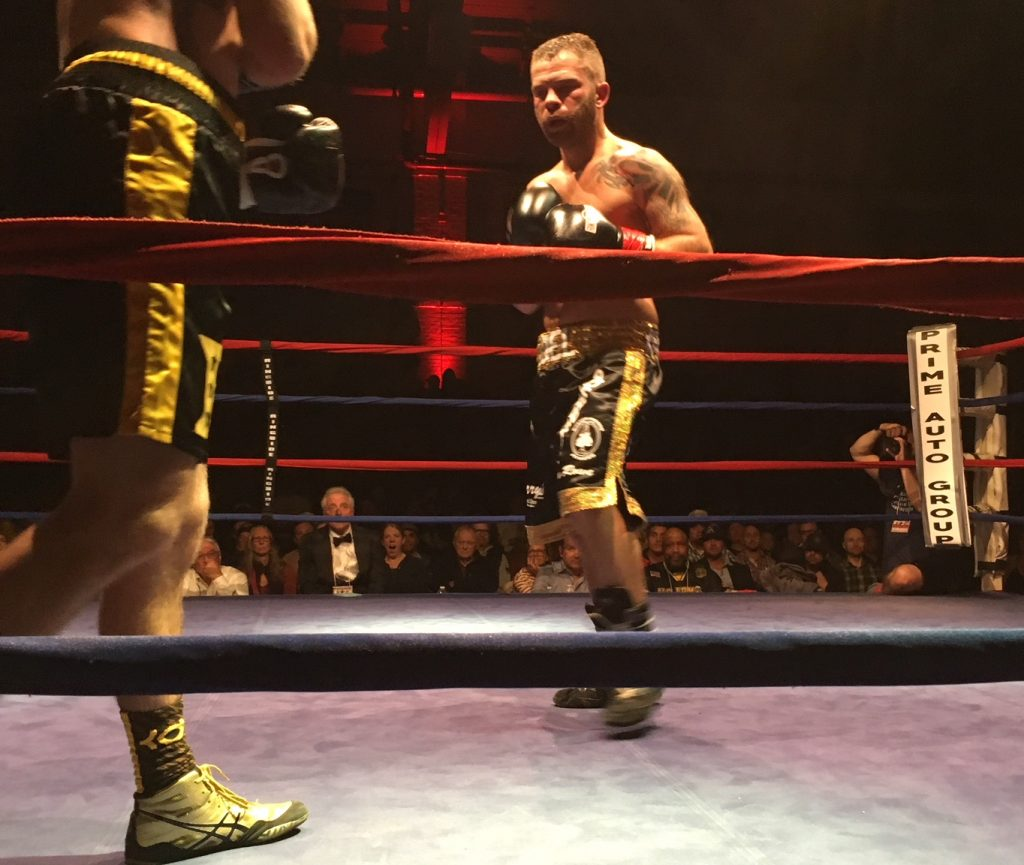 Brandon Berry of West Forks stands in the center of the ring during his fight Saturday night at the Portland Expo.