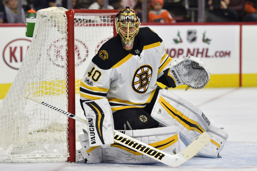 Boston Bruins goalie Tuukka Rask looks for a loose puck while guarding the post during the second period of Saturday's game against Flyers in Philadelphia.