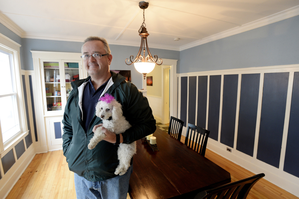 Lars Whelan inside his home and AirBnB rental on Noyes Street in Portland. Wheland is a member of Share Portland, a group of short-term rental operators, and says he doesn't know where the shortfall in registration came from as the city gave plenty of notice.