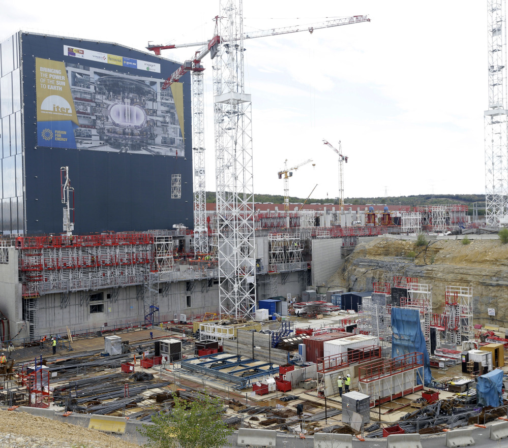 Cranes stand at the construction site of the International Thermonuclear Experimental Reactor in southern France. The design calls for a doughnut-shaped device called a tokamak that will trap superheated hydrogen to allow atoms to fuse together.
