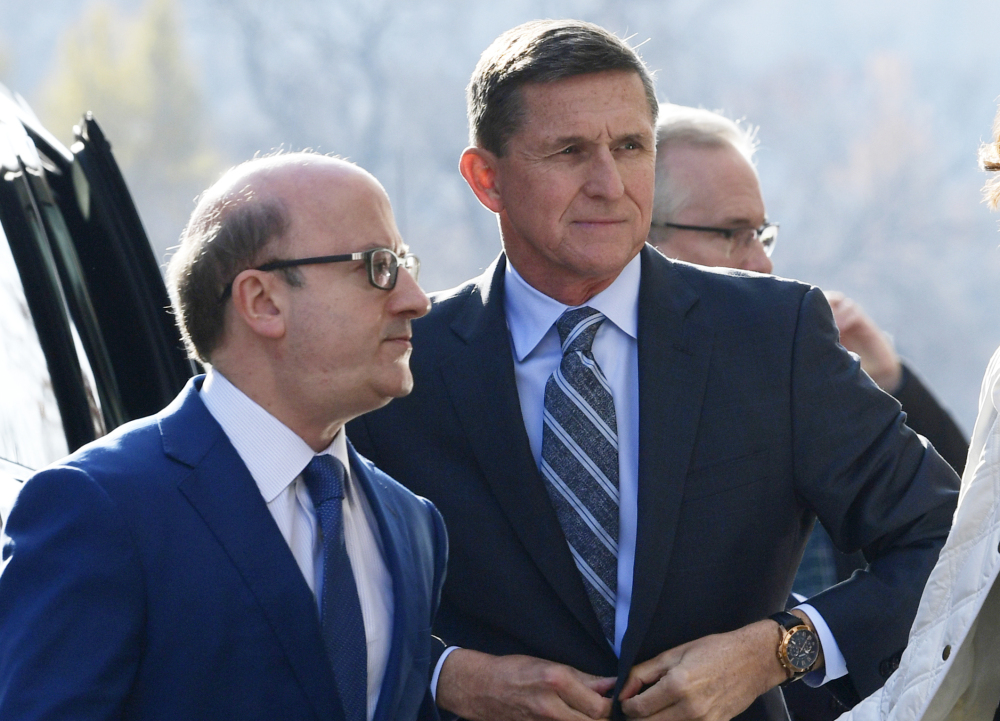 Former national security adviser Michael Flynn, right, is accused of texting a business associated about nuclear deals.