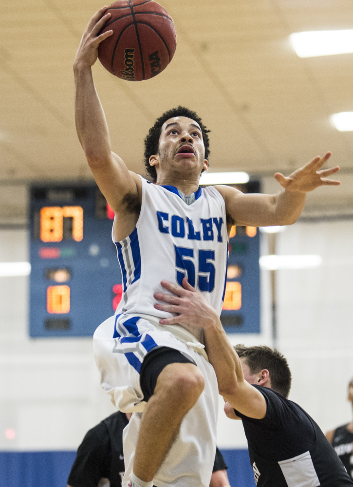 Colby's Wallace Tucker (55) draws the foul from Bowdoin College's Jack Bors (5) on the breakaway Saturday at Colby College in Waterville.