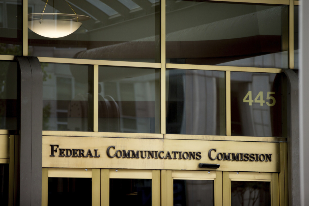 FILE - This June 19, 2015, file photo, shows the Federal Communications Commission building in Washington. Trumpism is slowly taking hold on your phone and computer, as the FCC starts rolling back Obama-era measures, known as