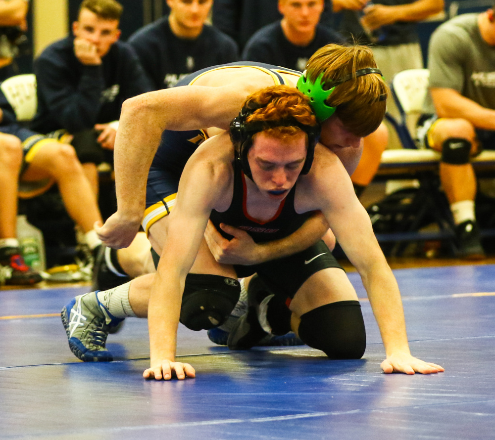 Contributed photo/USM athletics   University of Southern Maine sophomore Peter Del Gallo, back, gets a hold of Shawn Ferrell of Bridgewater State during a 125-pound match at the Costello Sports Complex in Gorham. Del Gallo pinned Ferrell in 48 seconds.