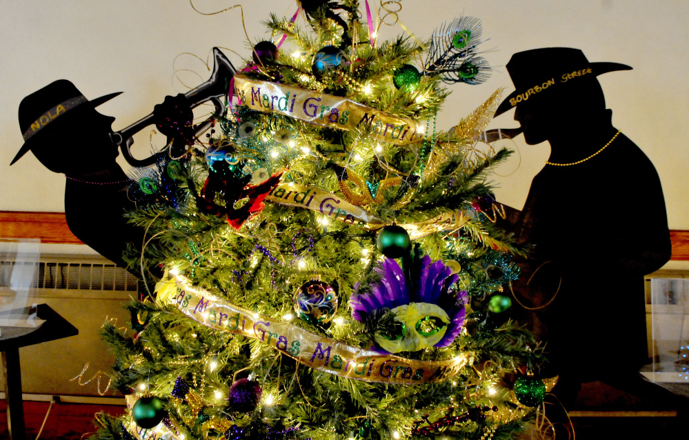The Mardi Gras tree sponsored by the Triple C Dance Team is one of many decorated Christmas trees at the Good Will-Hinckley Festival of Trees in Fairfield. The festival begins Friday and runs through Dec. 16.
