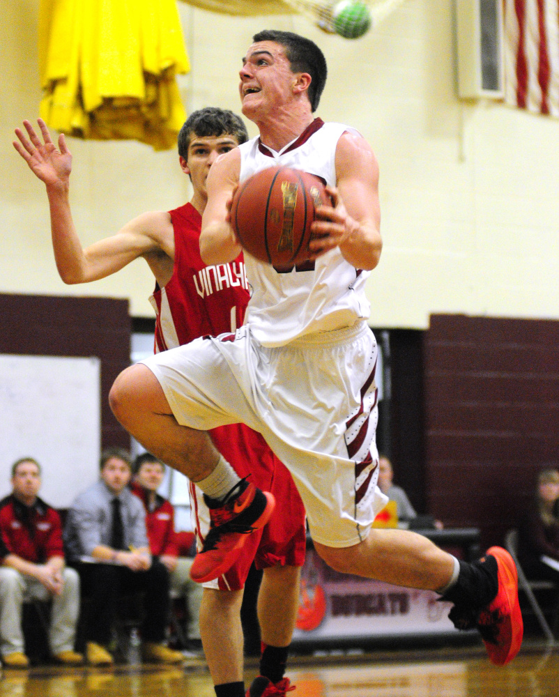 Richmond's Zach Small goes hard to the rim during a game last season against Vinalhaven. Small and the Bobcats have big expectations this season.