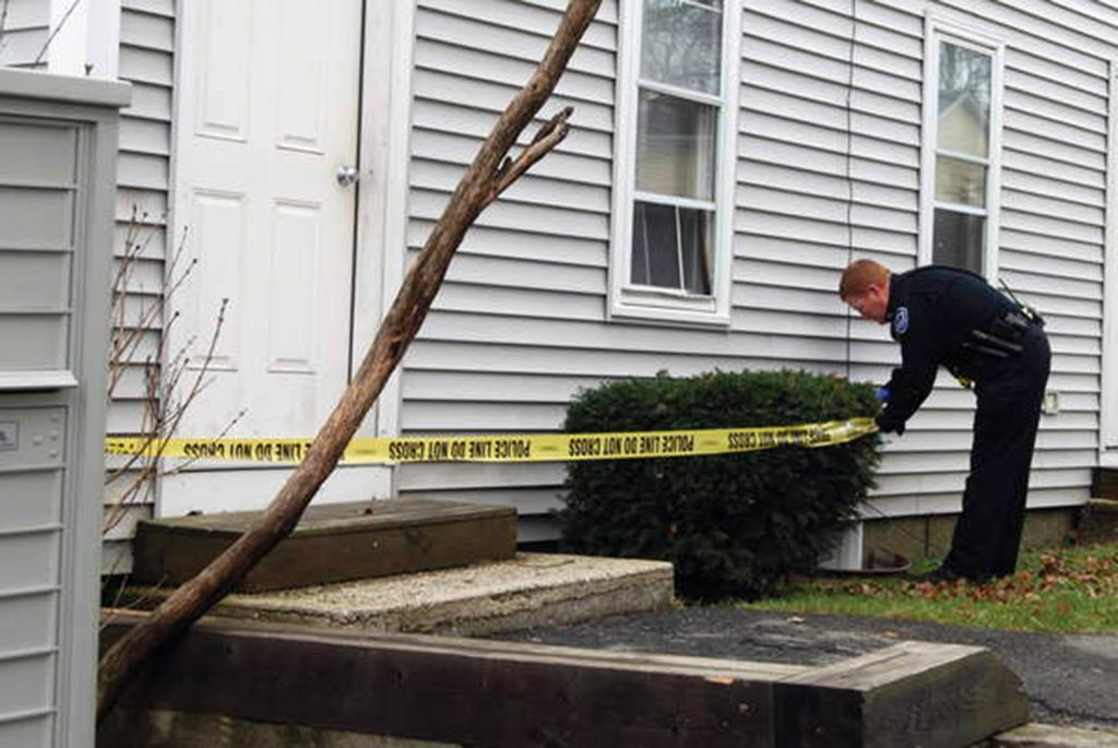 The scene of two stabbings is secured on Knox Street in Rockland.