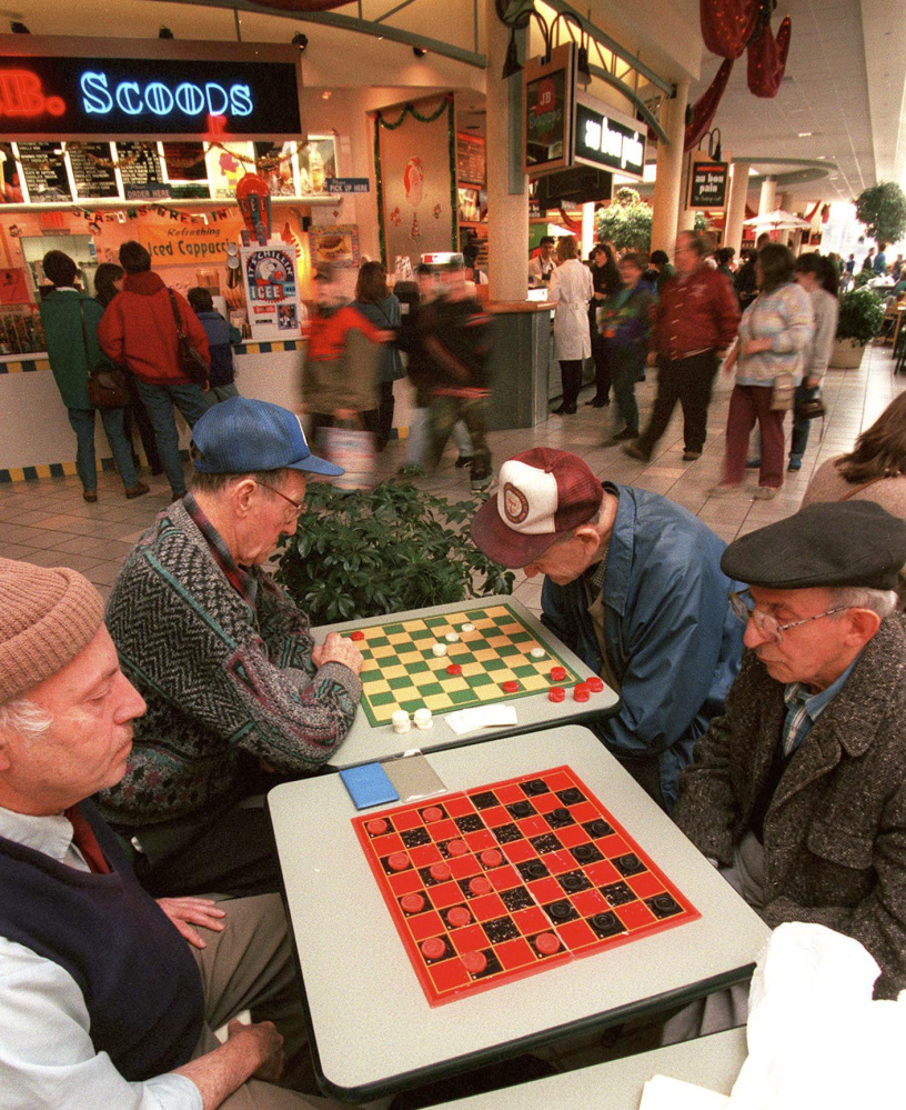 Saturday, November 23, 1996 -- (l-r) Warren Braverman, Rodney Scoville, Nate Cohen and Jim Bruni form an island of stillness among the early Saturday morning Maine Mall crowd as they gather for checkers.