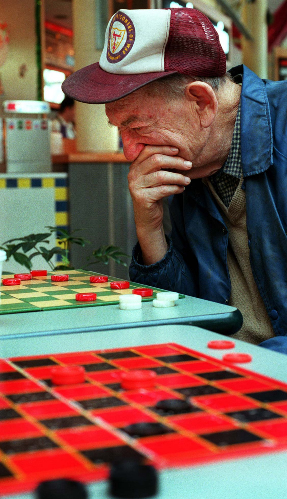 Saturday, November 23, 1996 -- Nate Cohen ponders his next move as he competes with Rodney Scoville at the Maine Mall.