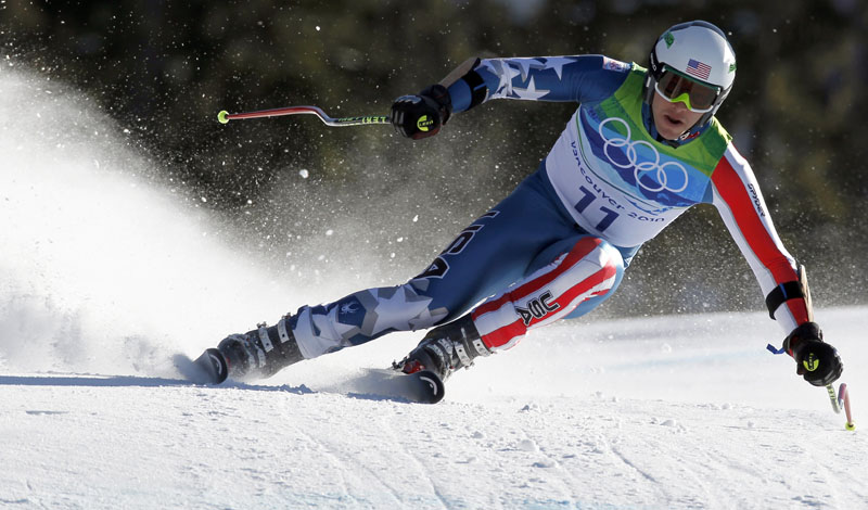 Bode Miller of the United States speeds down the course during the Men's super-G. Miller took the silver medal, trailing by 0.28 seconds, making him the most decorated American Alpine skier in history.