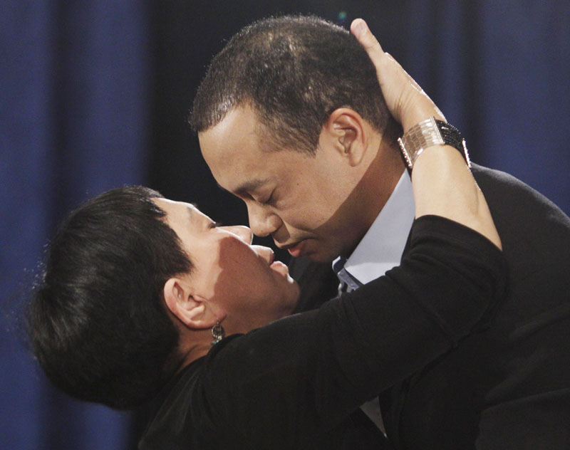 Tiger Woods hugs and kisses his mother, Kultida Woods, during his news conference today in Ponte Vedra Beach, Fla.