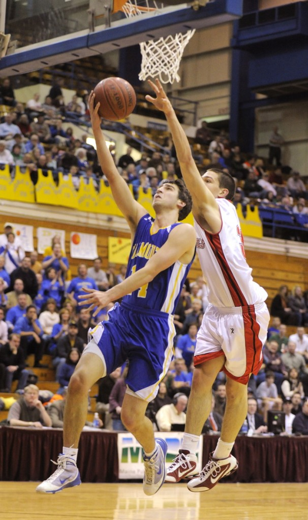Sam Horning of Falmouth puts up a shot against Tyler McFarland.