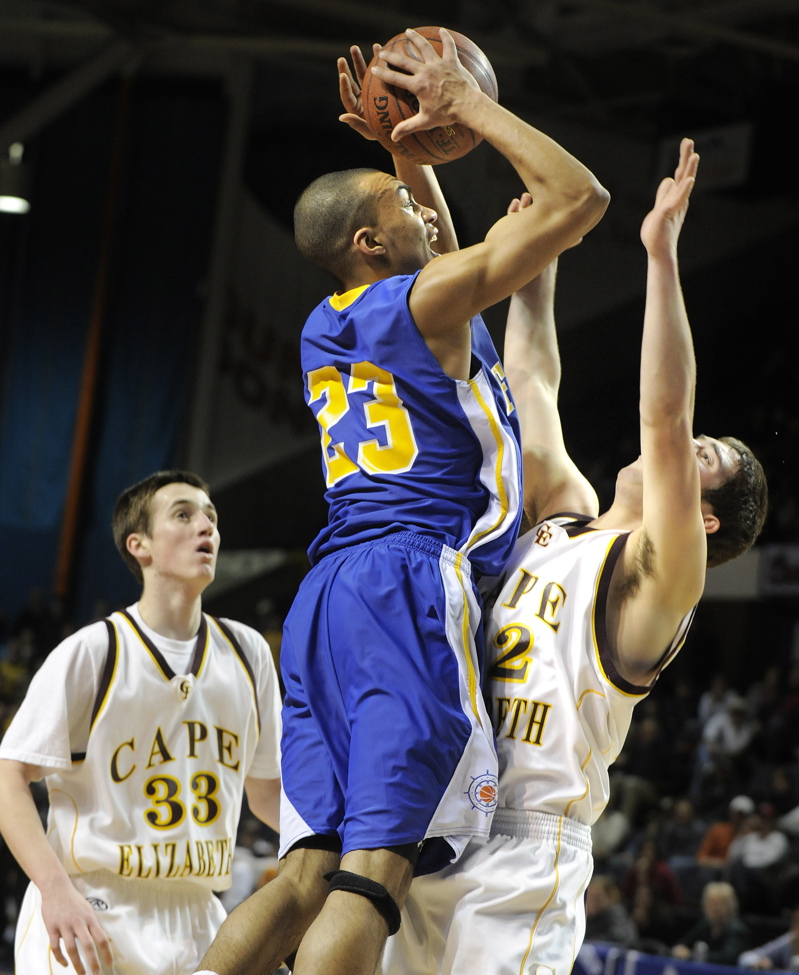Jahrel Registe goes up for a shot against Ben Brewster.