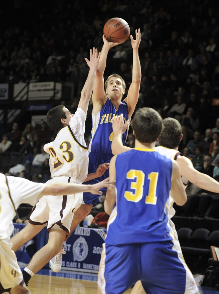 Stefano Mancini shoots a jumper over Tanner Garrity. Mancini finished with 24 points.