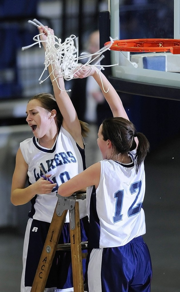 Gretel Breton, left, and Miranda Drinkwater cut down the net after their team's 46-29 victory over Rangeley in the Western Class D girls' basketball championship game at the Augusta Civic Center.