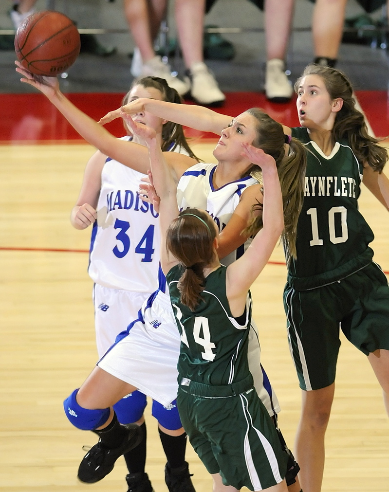 Ali Russell goes up for a shot under pressure from Waynflete defenders Sophie Richards-Connolly, left, and Lydia Stegemann.