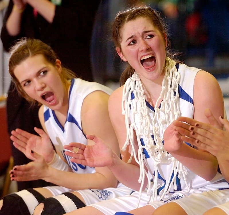 Marlisa Emerson, left, and Bianca Stoutamyer cheers while teammmates get their medals after the game.