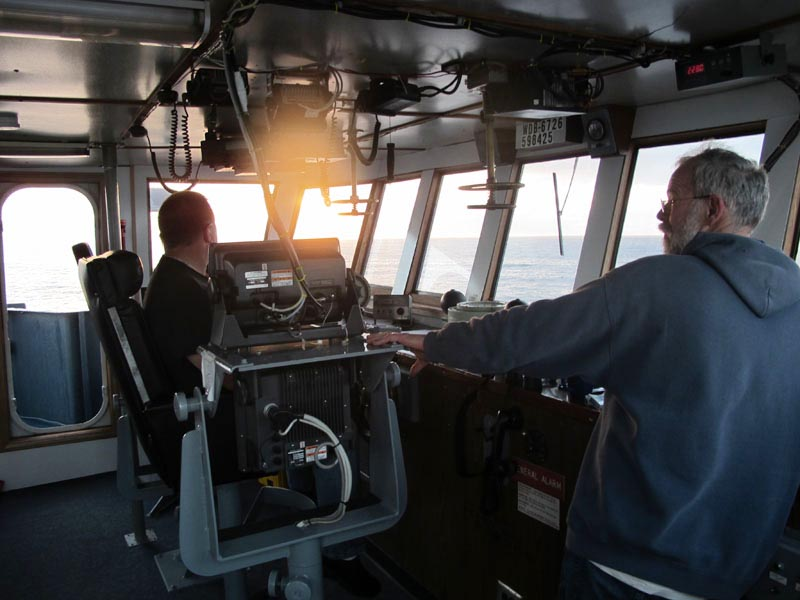 Shipmaster Kevin Garthwaite of Wells, right, and Chief Engineer Brian Ryder of West Bath take in the sunrise this morning as the Sea Hunter sails for Haiti.