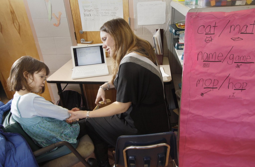 Special education teacher Paige Fournier works with Emily Martin at Moore Middle School in Portland. Emily's parents praise Fournier for seeing Emily as a person who can learn.