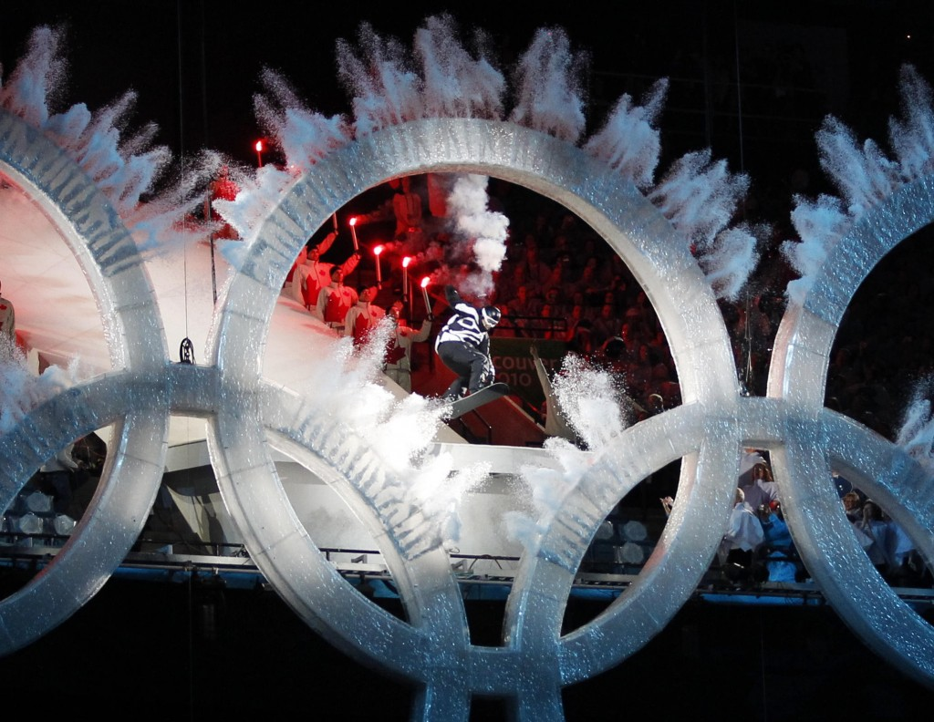 A snowboarder sails through the Olympic rings during the opening ceremony for the Vancouver 2010 Olympics in Vancouver, British Columbia, Friday, Feb. 12, 2010. (AP Photo/Mark Baker)