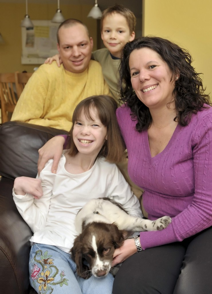 Emily Martin, 12, with her mother, Kirsten, father, Jeff, brother, Jack, 7, and puppy Reagan. Emily's special ed teacher saw her potential and shifted the focus onto her abilities.
