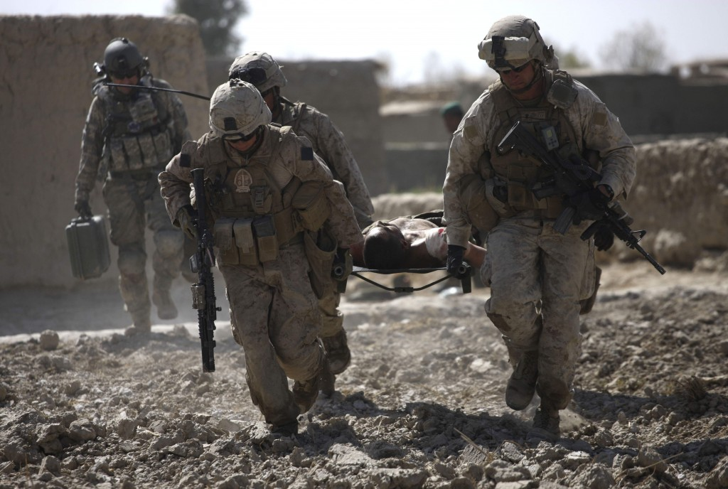 U.S. Marines carry a wounded Afghan National Army soldier to a waiting U.S. Army Task Force Pegasus medevac helicopter, in Marjah, Helmand province, Afghanistan, Wednesday Feb. 17, 2010. Pegasus aeromedical crews have been attacked regularly over the past days while evacuating the wounded as U.S. and Afghan troops take part in an assault in the Taliban stronghold of Marjah. (AP Photo/Brennan Linsley)