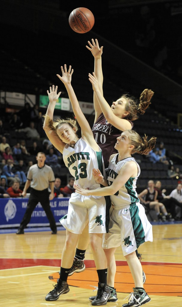 Photos by John Ewing/Staff Photographer Chelsea Bridges of Greely shoots over Amanda Jordan, left, and Abbey Randall of Leavitt during Greely's 59-38 victory Thursday in a Western Class B semifinal.