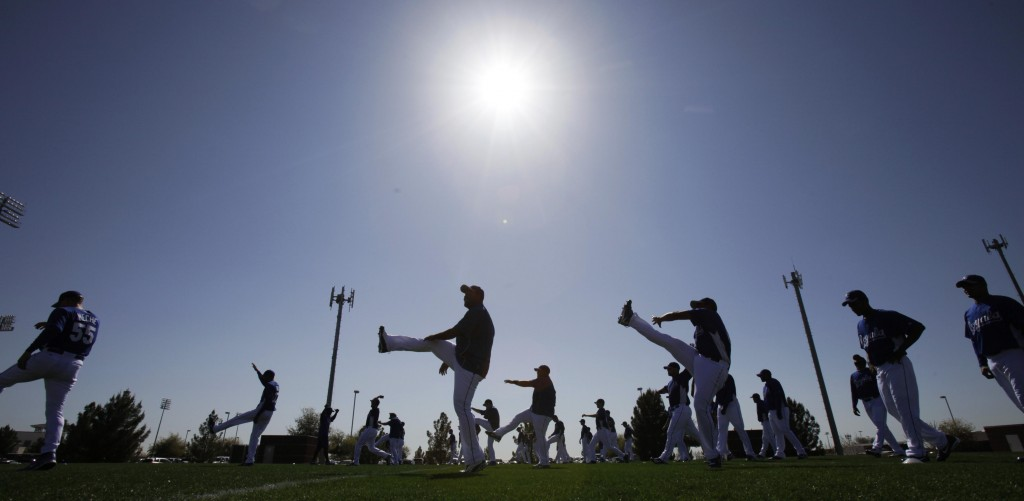 Kansas City Royals players stretch on the team's first day of baseball spring training for pitchers and catchers, Thursday, Feb. 18, 2010, in Surprise, Ariz. (AP Photo/Charlie Neibergall)