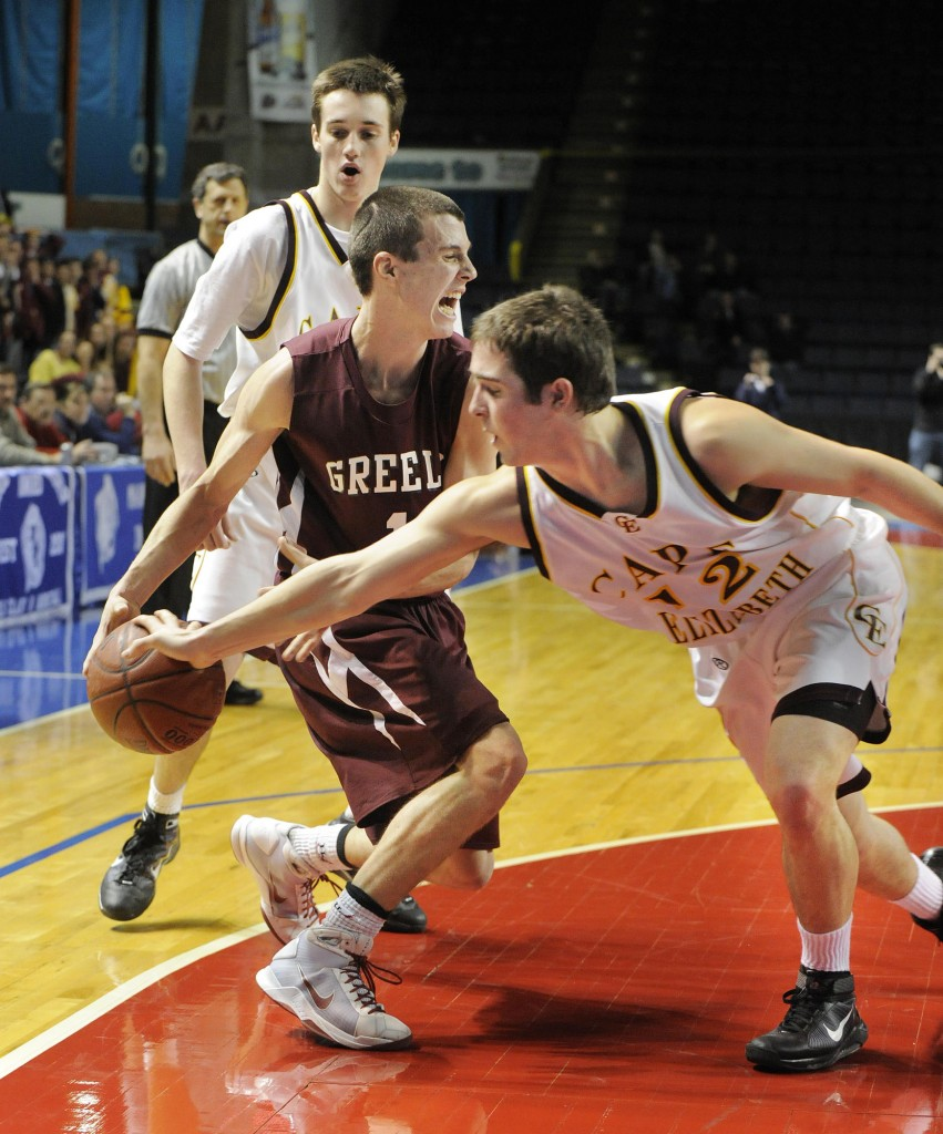 John Ewing/Staff Photographer Ben Brewster of Cape Elizabeth knocks the ball from Sam Johnston of Greely during the closing seconds of the Capers' 51-43 victory Thursday night at the Civic Center.
