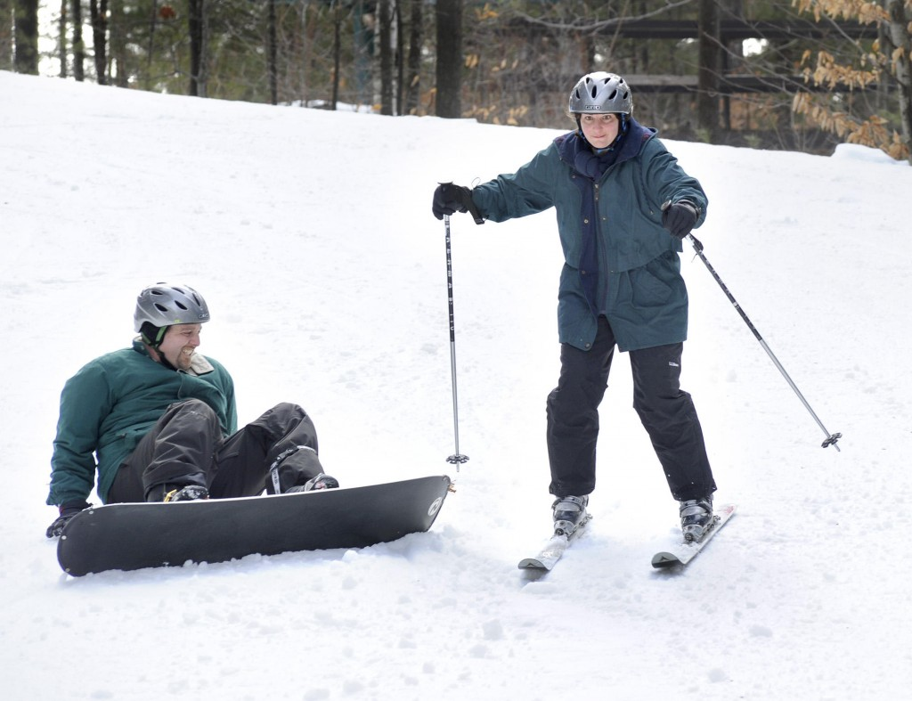 Drew Sachs and wife Melanie, children Deidre, 11, and Peter, 9, learn to ski and snowboard at Lost Valley in Auburn on Feb. 19. Melanie Sachs, above, skis past Drew.