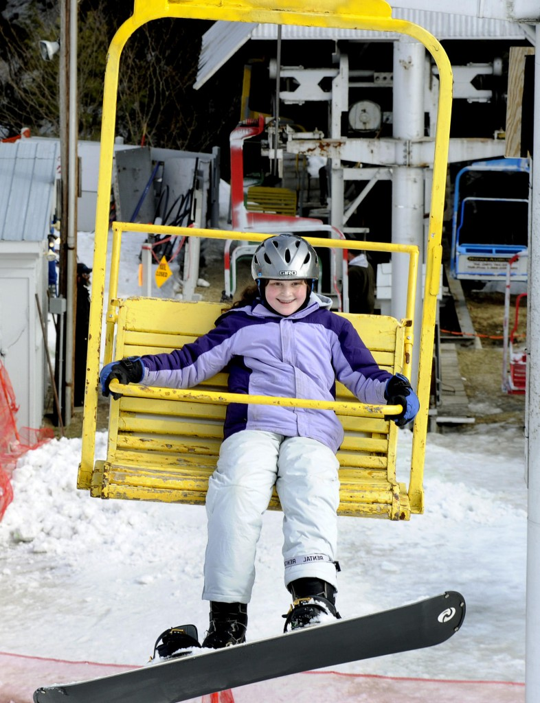 Deidre aces her first ride on a chairlift.