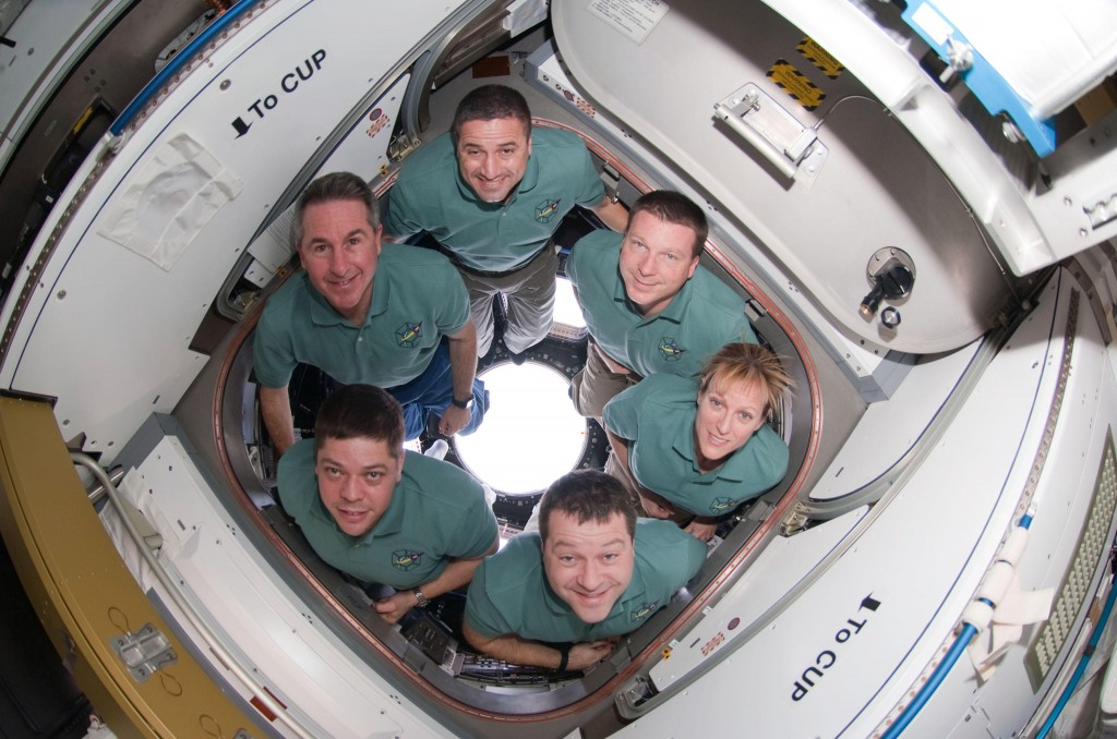 Endeavor crew members pose in the newly installed cupola of the space station. Pictured clockwise from the top are: NASA astronauts George Zamka, commander; Terry Virts, pilot; and Kathryn Hire, Nicholas Patrick, Robert Behnken and Stephen Robinson, mission specialists.