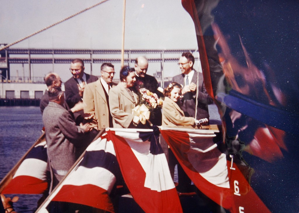 Deborah Gray christens the City of Portland III fireboat in East Boston on March 20, 1959, when she was 10 years old. Behind her, in the beige coats, are her mother and father.