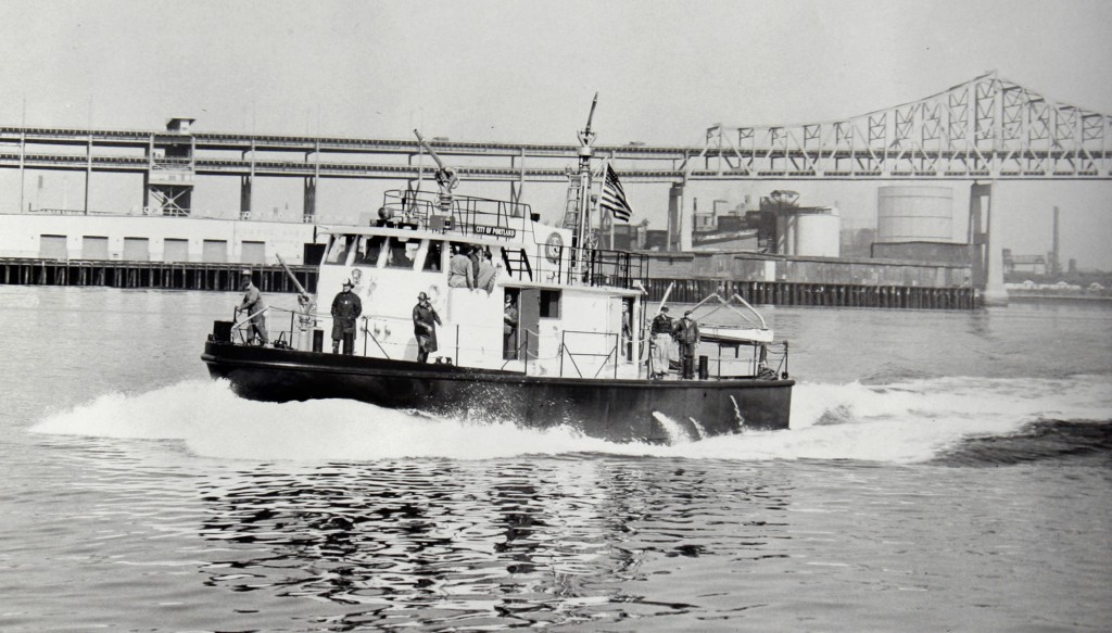The City of Portland fireboat, now known as the City of Portland III, and soon to be retired, leaves Boston Harbor where it was built and christened in 1959.