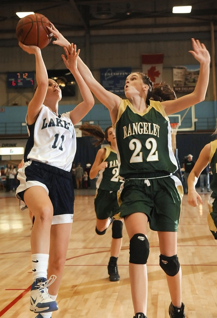 Staff photo by Joe Phelan Rangeley sophomore forward Emily Carrier, right (22) blocks a shot by Greenville senior McKenna Peat Saturday during the Western Maine Class D regional game at the Augusta Civic Center.