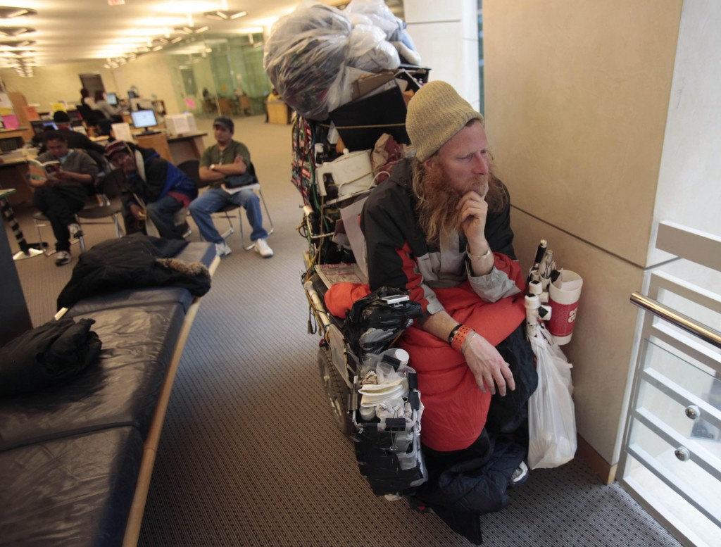 IJohn Banks, who is homeless, sits in his wheelchair at the San Francisco Public Library. He prefers to be left alone.