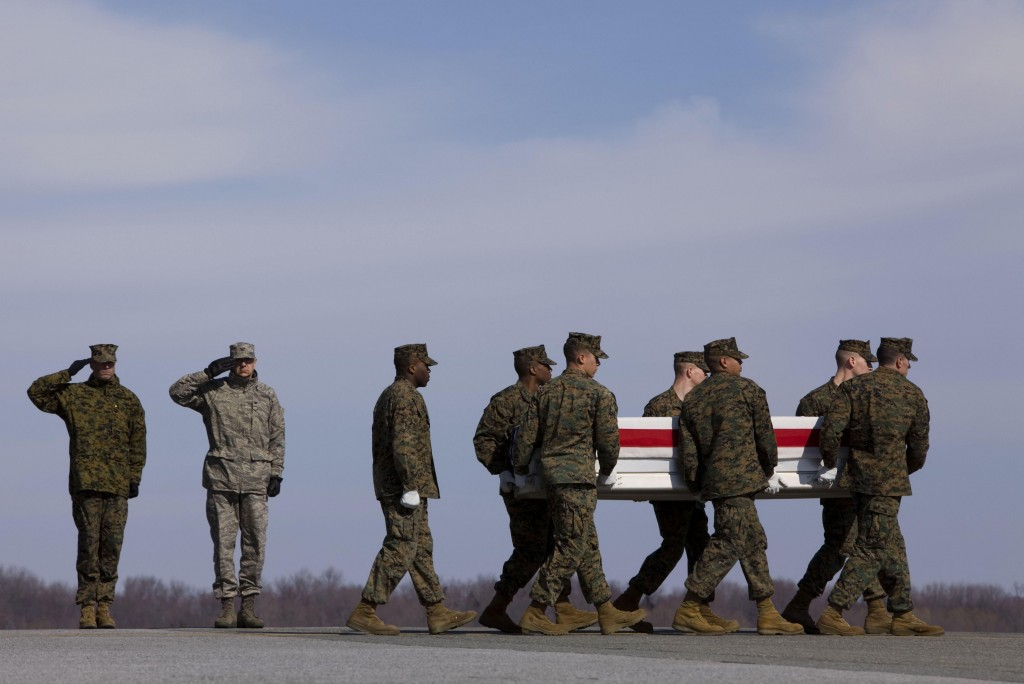 U.S. Marines carry the remains of Lance Cpl. Kielin T. Dunn on Saturday at Dover Air Force Base in Delaware. Dunn, of Chesapeake, Va., was killed in Afghanistan. NATO said one service member died in a roadside bombing Sunday.
