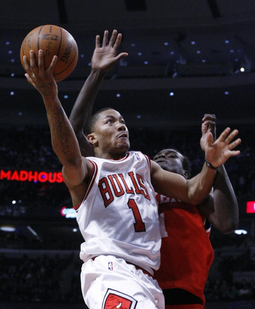 Derrick Rose of the Chicago Bulls drives past Samuel Dalembert of the Philadelphia 76ers during Chicago's 122-90 victory.
