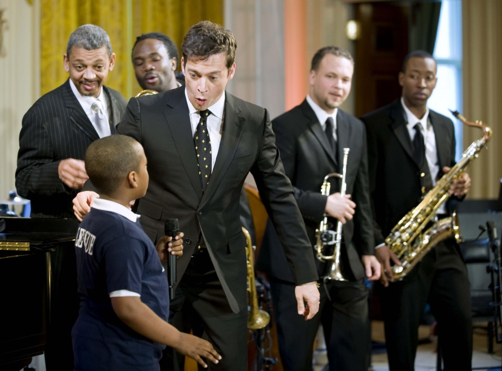 Musician Harry Connick Jr., center, talks with Derrick Hopkins Jr., 10, from the Myrtilla Miner Elementary School's glee club, during Sunday's preview performance of the White House's annual Governors' Ball.